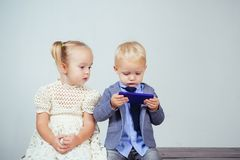 Modern child. Modern technologies for kids. Media addiction and technologies. Kids watching funny video on smartphone royalty free stock image