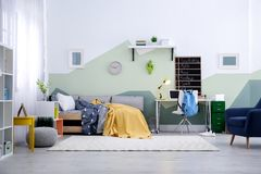 Modern child room interior with bed. Modern child room interior with comfortable bed Royalty Free Stock Photos