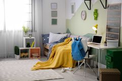 Modern child room interior with bed. Modern child room interior with comfortable bed Royalty Free Stock Photo