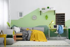 Modern child room interior with   bed. Modern child room interior with comfortable bed Stock Image