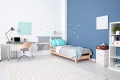 Modern child room interior with comfortable bed. And desk stock photo