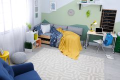Modern child room interior with   bed. Modern child room interior with comfortable bed Stock Images