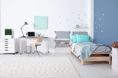 Modern child room interior with comfortable bed. And desk Royalty Free Stock Photos