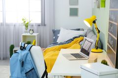 Modern child room interior with desk. And laptop Royalty Free Stock Image