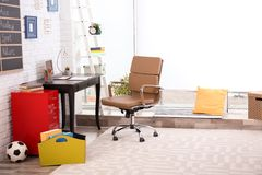 Modern child room interior with desk. And laptop Royalty Free Stock Photography