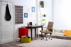 Modern child room interior with desk. And laptop Stock Photo