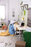 Modern child room interior with desk. And laptop Stock Images