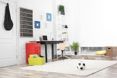 Modern child room interior with desk. And laptop Stock Photography