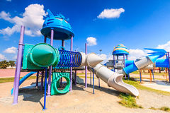 Modern children playground slide. At the amusement park in the city Royalty Free Stock Photos