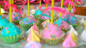 Modern children`s birthday party. Unicorn themed treats, close-up against colorful background. Modern children`s birthday party. Unicorn themed treats, against stock video