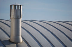 Modern chimney. A modern chimney on top of a recent building Royalty Free Stock Image