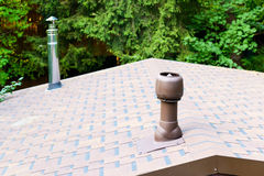 Modern chimneys on the roof Royalty Free Stock Photography
