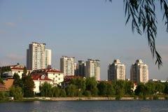 Modern Chinese city skyline. Tower block building skyline of modern Chinese city with river or sea in foreground Stock Photo