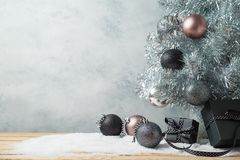 Modern Christmas background with gift boxes, pine tree and orna stock photos