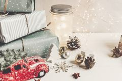 Modern christmas ornaments and car toy with tree, presents cones Stock Photography