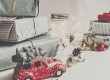 Modern christmas ornaments and car toy with tree, presents cones Stock Photo
