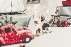 Modern christmas ornaments and car toy with tree, presents cones. Anise on white wooden background. merry christmas concept. seasonal greetings. happy holidays Stock Image