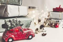 Modern christmas ornaments and car toy with tree, presents cones Royalty Free Stock Photo