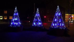 modern Christmas tree form street decorations and cars stock video