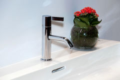 Modern chrome faucet in bathroom Royalty Free Stock Photography