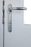Modern chrome high security door lock Royalty Free Stock Photos