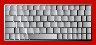 Modern chrome laptop bluetooth keyboard isolated on red Royalty Free Stock Photo