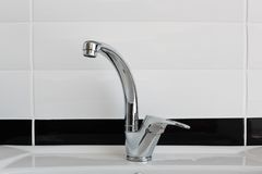Modern chrome metal tap Stock Photos
