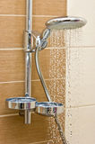 Modern chrome shower head. Closeup of a shower head with sprinkling water, massaging stream stock photography