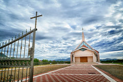 Modern church and cloudy sky above Royalty Free Stock Image