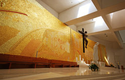 Modern church interior. With mosaic and crucifix on altar in contemporary style, Fatima, Portugal stock photo