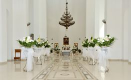 Modern church interior. Interior of church with flowers stock photography
