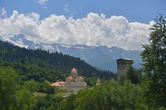 Modern church and old tower in Caucasus Mountains Royalty Free Stock Images
