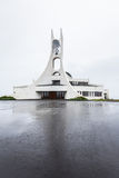 Modern church Stykkisholmskirkja in Iceland. BORGARBRAUT, STYKKISHOLMUR, ICELAND -   JUNE 24, 2014: Church Stykkisholmskirkja was inaugurated 1990, designed by Royalty Free Stock Photography
