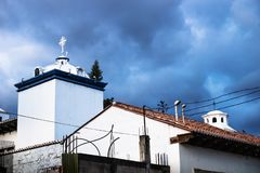 Modern churchtowers on dramatic blue cloudscape in Antigua, Guatemala. Modern white churchtowers on dramatic blue cloudscape in Antigua, Guatemala royalty free stock images