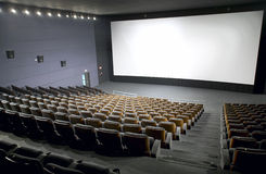 Modern cinema interior with seats and screen. Horizontal Royalty Free Stock Photos