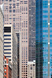 Modern city. Pattern of tall modern urban buildings standing without gaps between them Stock Image