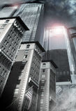 Modern City. Modern business background of skyscrapers with brick buildings in front and cloudy sky Stock Images