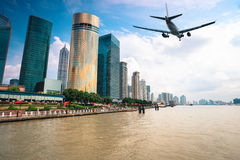 Modern city with aircraft stock images