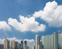 Modern city apartments buildings with clouds above it Stock Photography