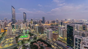 Modern city architecture of Abu Dhabi skyline day to night timelapse, UAE. stock video footage