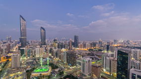 Modern city architecture of Abu Dhabi skyline day to night timelapse, UAE. stock video