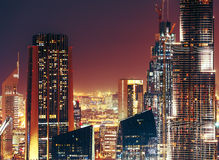 Modern city architecture by night. Business bay, Dubai, United Arab Emirates. Royalty Free Stock Photography