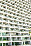 Modern city building exterior with many rooms with balconies stock photography