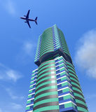 Modern city building and a plane in the sky. Stock Photos