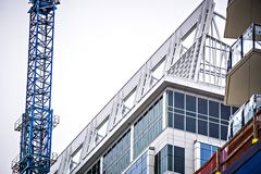 Modern city buildings under construction or maintenance Stock Images