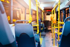 Modern city bus interior and seats royalty free stock photo