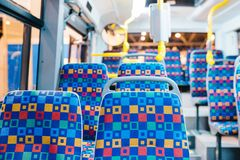 Modern city bus interior and seats royalty free stock photos