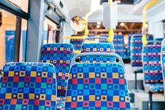 Modern city bus interior and seats royalty free stock photos