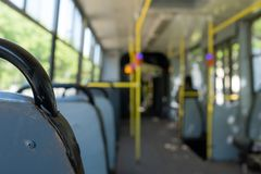 Modern city bus interior and seats. Public transport royalty free stock photo