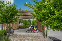 Cyclist resting on a bench on a walkway Royalty Free Stock Photos